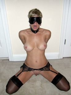 Blindfolded wife with hands..