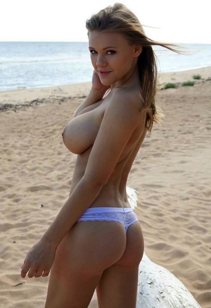 Big tits on the beach,..